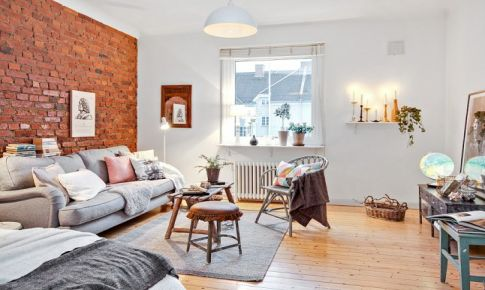 34平米公寓装修效果图 用裸砖墙来做客厅背景